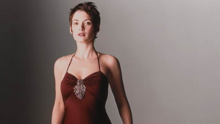 Winona Ryder In Brown Dress Modeling Pose