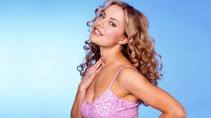 Xenia Seeberg White N Pink Dress Smiling Side Pose