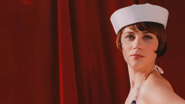 Zooey Deschanel Side Face Wearing A White Hat