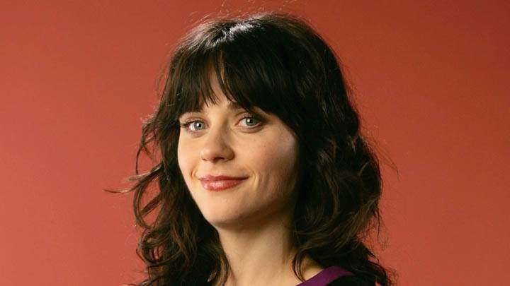 Zooey Deschanel Smiling In Front Of Camera