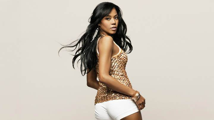 Amerie Looking Back In White N Golden Dress