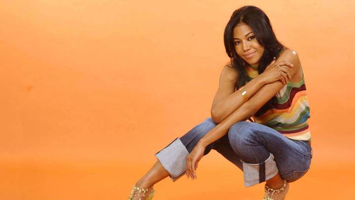 Amerie Smiling Face N Orange Background