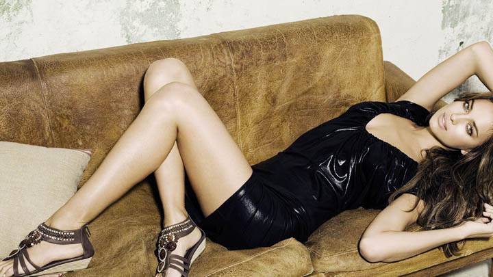 Irina Shayk Laying Pose On Sofa In Black Dress