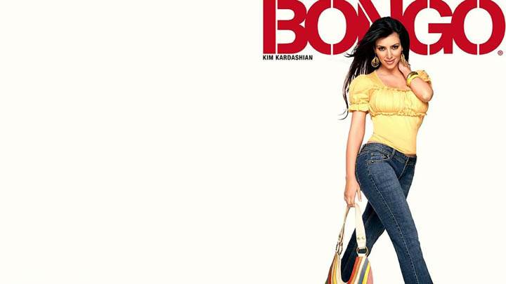 Kim Kardashian In Yellow Top N Blue Jeans
