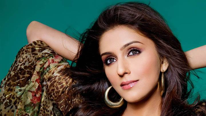 Aarti Chhabria Glossy Pink Lips & Smiling