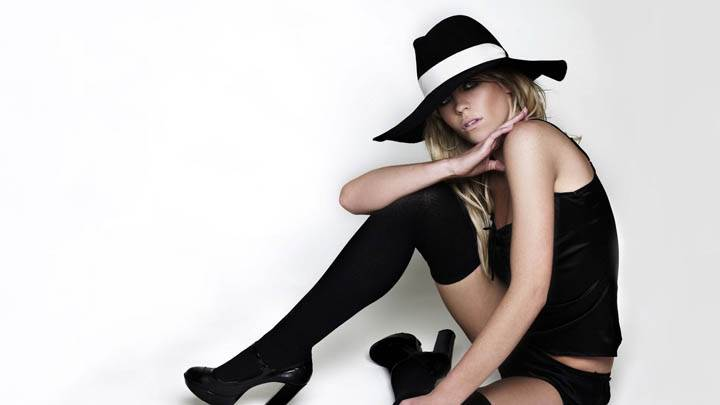 Abigail Clancy Sitting Pose Wearing Black Hat & Dress