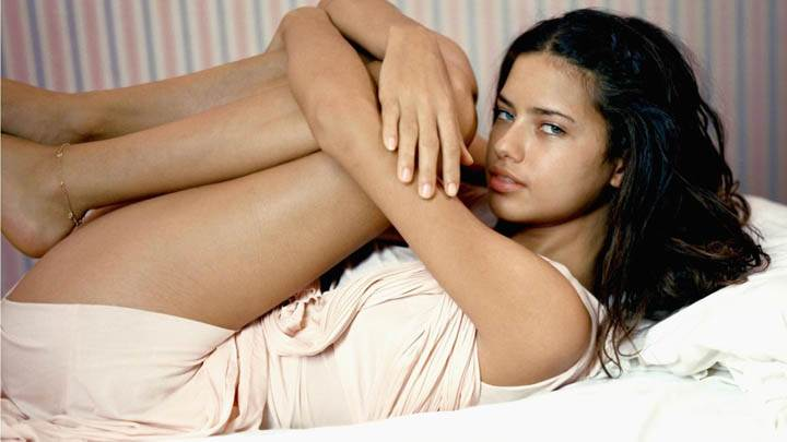 Adriana Lima Laying on Bed Photoshoot