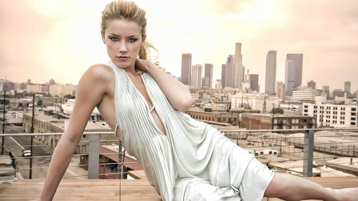 Amber Heard Sitting Pose on Roof in White Dress