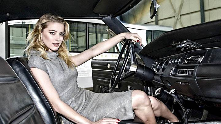 Amber Heard Sitting in Car Looking at Camera
