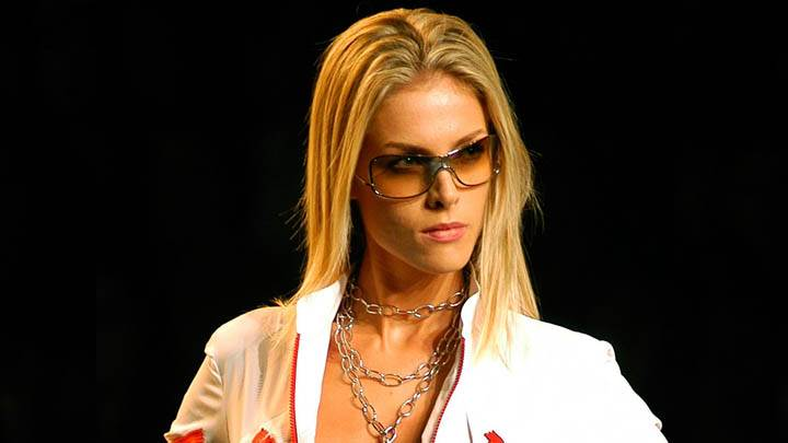 Ana Hickmann in Goggles & White Dress And Black Background