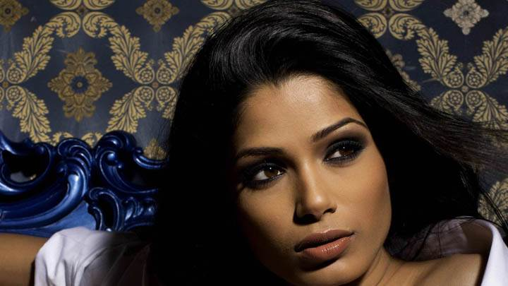Freida Pinto Glossy Lips & Brown Eyes Face Closeup
