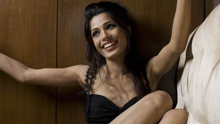 Freida Pinto Happy Smiling Sitting Pose on Sofa