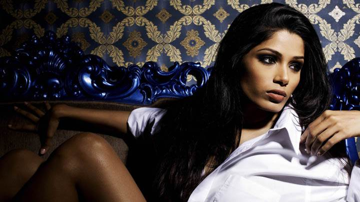 Freida Pinto Looking Side in White Shirt