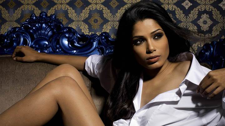 Freida Pinto Sitting in White Shirt Photoshoot