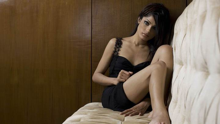 Freida Pinto Sitting on Sofa Looking Front Pose