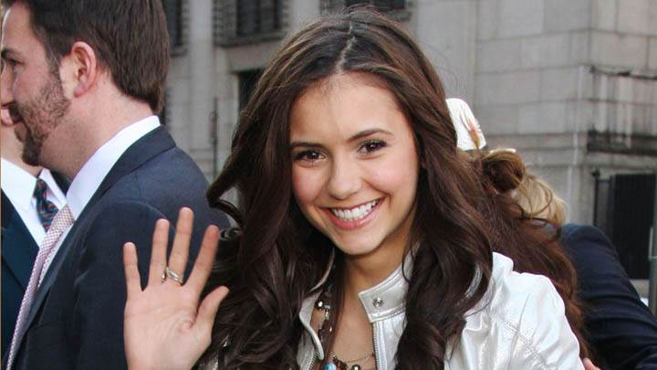 Nina Dobrev Smiling & Saying Bye in White Jacket