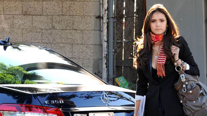 Nina Dobrev Standing Outside Car With a Brown Bag