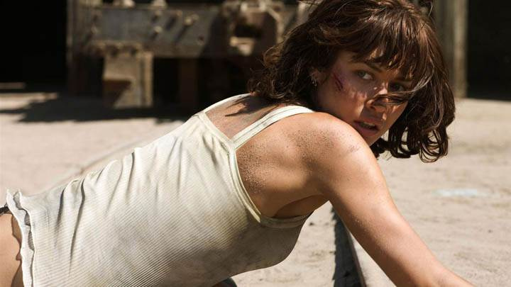 Olga Kurylenko Looking Back in White Top
