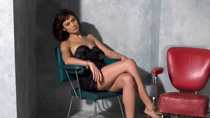 Olga Kurylenko Sitting on a Green Chair