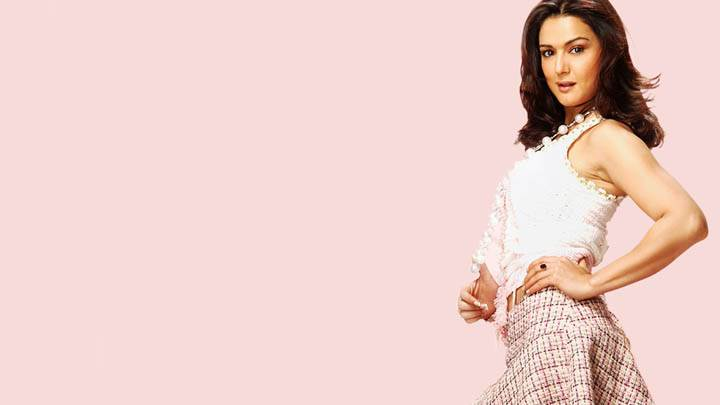Preity Zinta – In White Top And Colorful Skirt