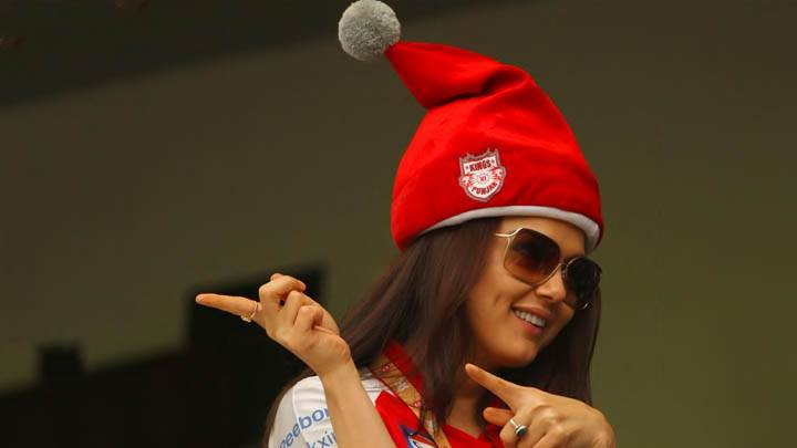 Preity Zinta – Smiling & Wearing A Red Hat