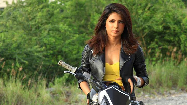 Priyanka Chopra Sitting on Bike in Black Jacket