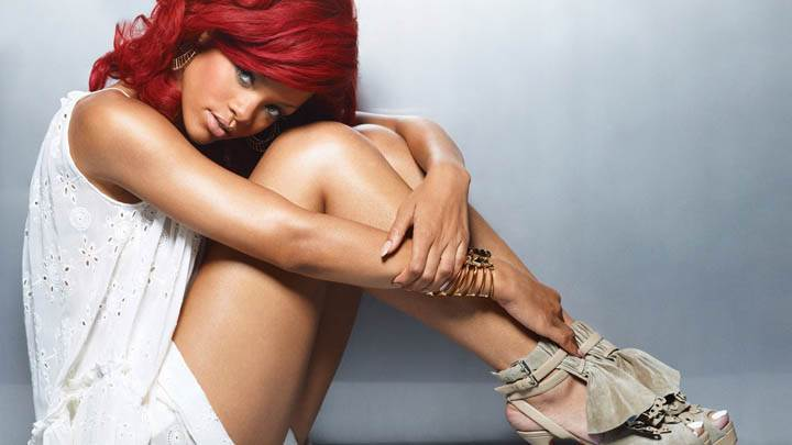 Rihanna in White Dress & Red Hair Sitting Pose