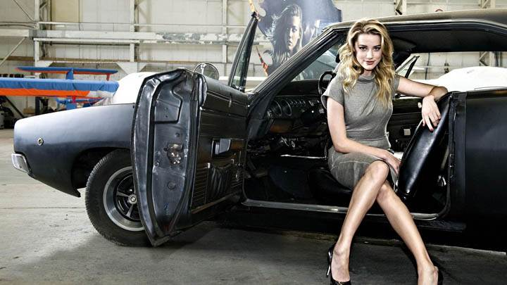 Amber Heard Sitting on a Car Seat