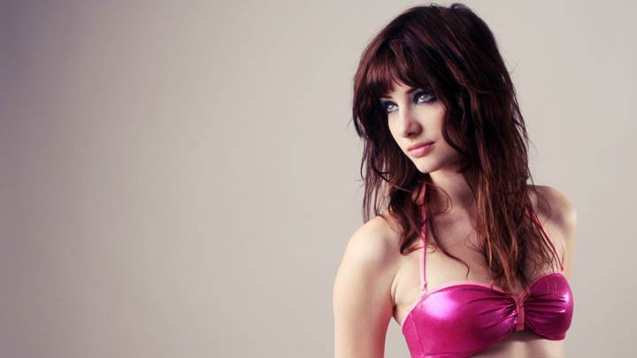 Susan Coffey Looking Side in Pink Bikinis