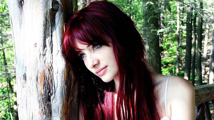 Susan Coffey Smiling Sitting With Tree Photoshoot