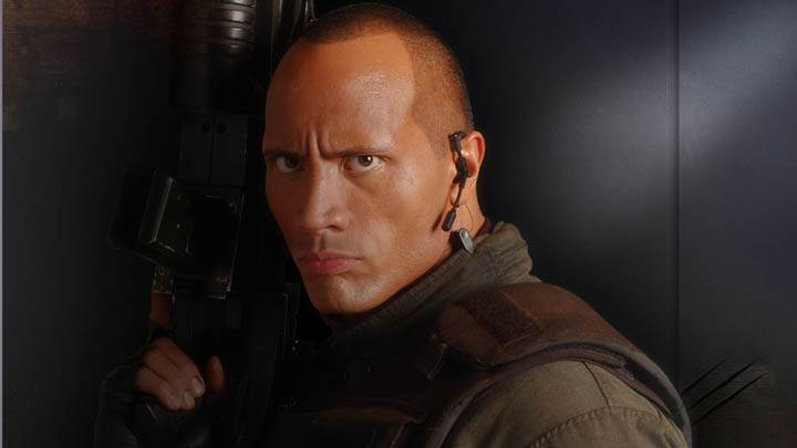 Dwayne Johnson Holding A Gun In Doom