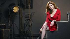 Dana Delany Sitting on Stairs in Red Long Dress