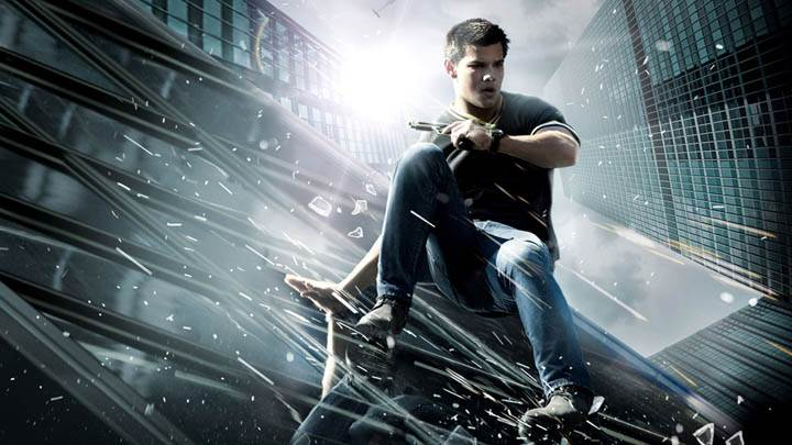 Abduction – Taylor Lautner Sitting On Abuilding Glass