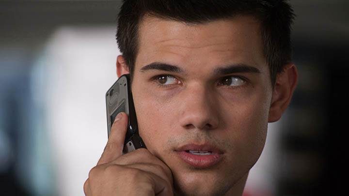 Abduction – Taylor Lautner Talking On Phone, Face Closeup