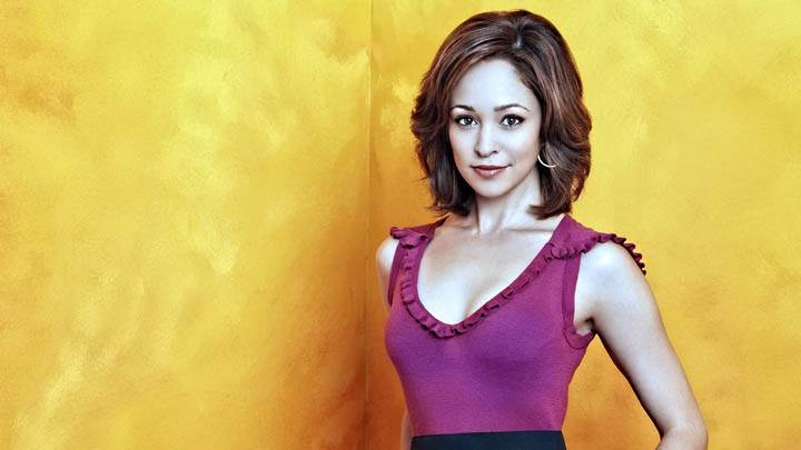 Autumn Reeser Smiling Face & Yellow Background