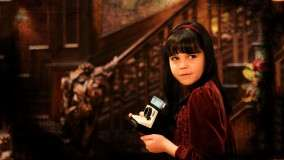 Bailee Madison Holding A Camera In Don't Be Afraid Of The Dark