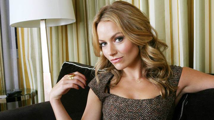 Becki Newton Pink Lips & Sitting Pose on Black Sofa