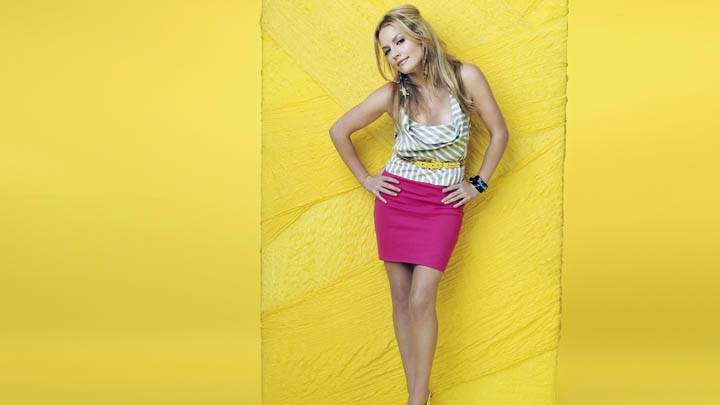 Becki Newton Modeling Pose N Yellow Background
