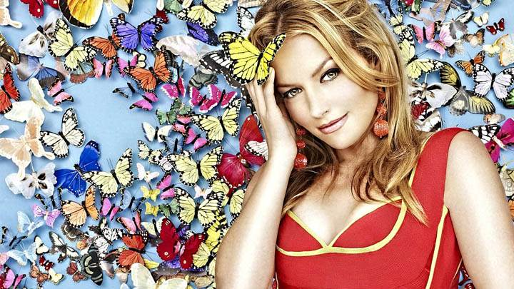 Becki Newton in Red Dress & Butterfly Background