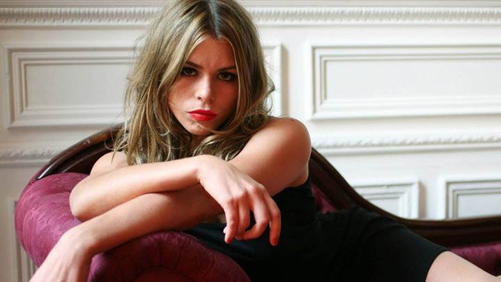 Billie Piper Red Lips in Black Dress Sitting on Sofa