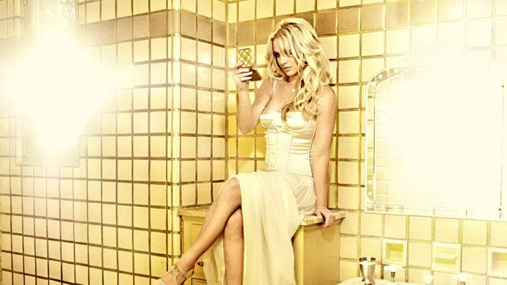 Britney Spears Sitting Pose in Golden Tiled Bathroom