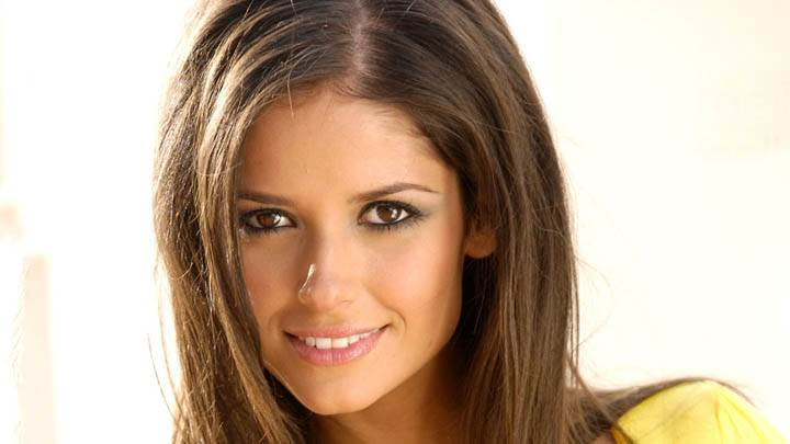 Carla Ossa Smiling & White Background