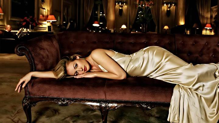 Cat Deeley Laying Pose on Red Sofa