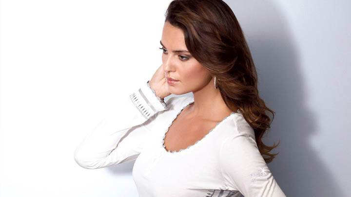 Catrinel Menghia In White Top Side Pose Photoshoot