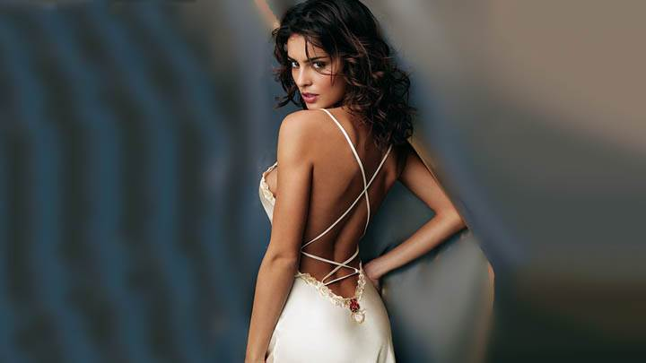 Catrinel Menghia Looking Back In White Dress