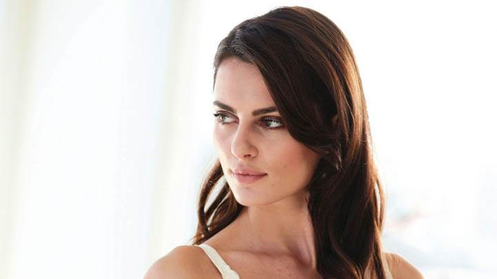 Catrinel Menghia Cute Side Face Photoshoot In Bikini