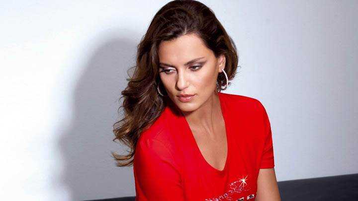 Catrinel Menghia Sad Sitting Pose In Red Top