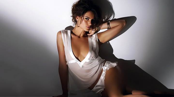 Catrinel Menghia Sitting In White Dress