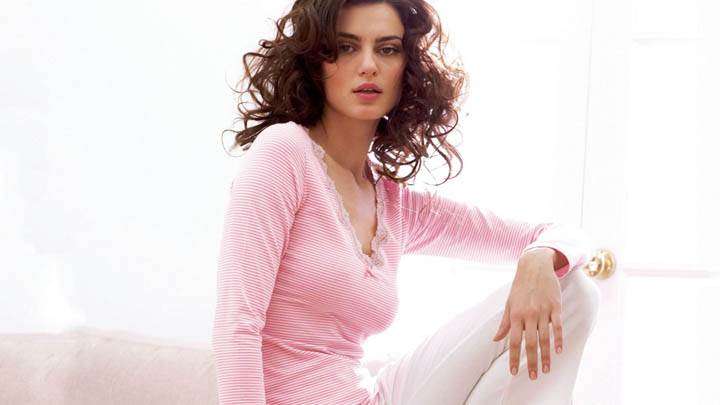 Catrinel Menghia Sitting In White Pink Top