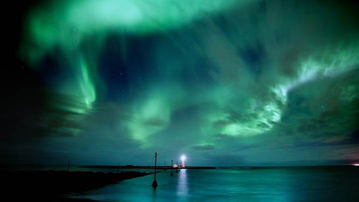 Green Clouds & Light House At Sea Side